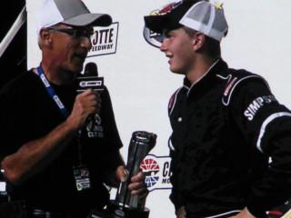 PRN announcer Lenny Batycki interviews William Byron after his first Legends win during Charlotte Motor Speedway's annual Summer Shootout in 2013. Photo courtesy Lenny Batycki.