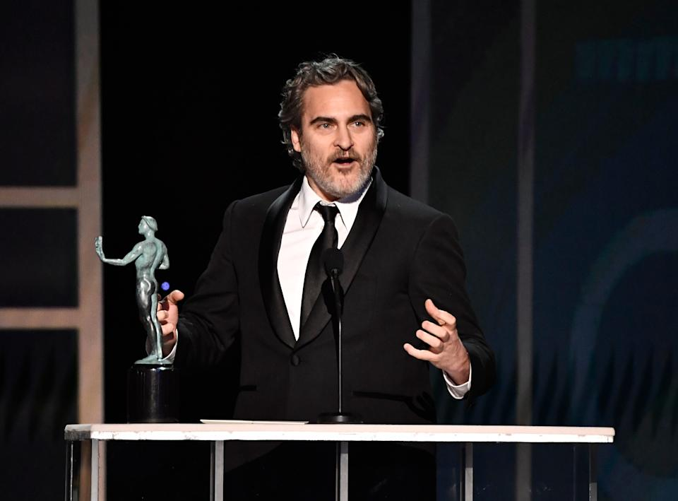 """Joaquin Phoenix accepts his best actor award for """"Joker"""" and celebrates his fellow nominees during the 26th annual Screen Actors Guild Awards."""