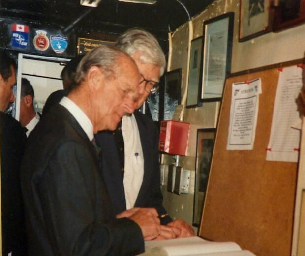 This picture of Prince Philip in 1997 hangs on the wall at Crow's Nest Officers' Club. Next to it is a photo of his first visit to the club in 1951.