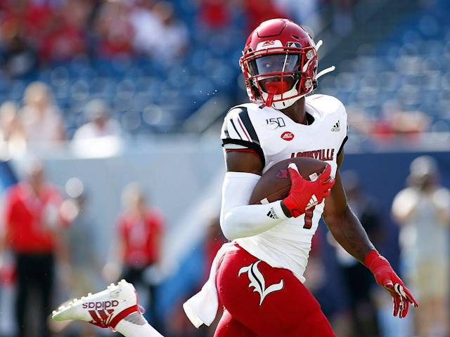 <p>Louisville wide receiver Tutu Atwell looks back as he runs for a touchdown during a game between the Cardinals and Western Kentucky, Sept.14, 2019, at Nissan Stadium in Nashville, Tennessee.</p>