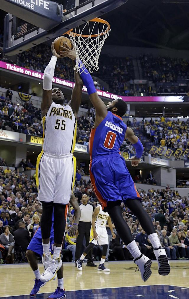 Indiana Pacers center Roy Hibbert, left, shoots over Detroit Pistons center Andre Drummond in the second half of an NBA basketball game in Indianapolis, Monday, Dec. 16, 2013. The Pistons defeated the Pacers 101-96. (AP Photo/Michael Conroy)