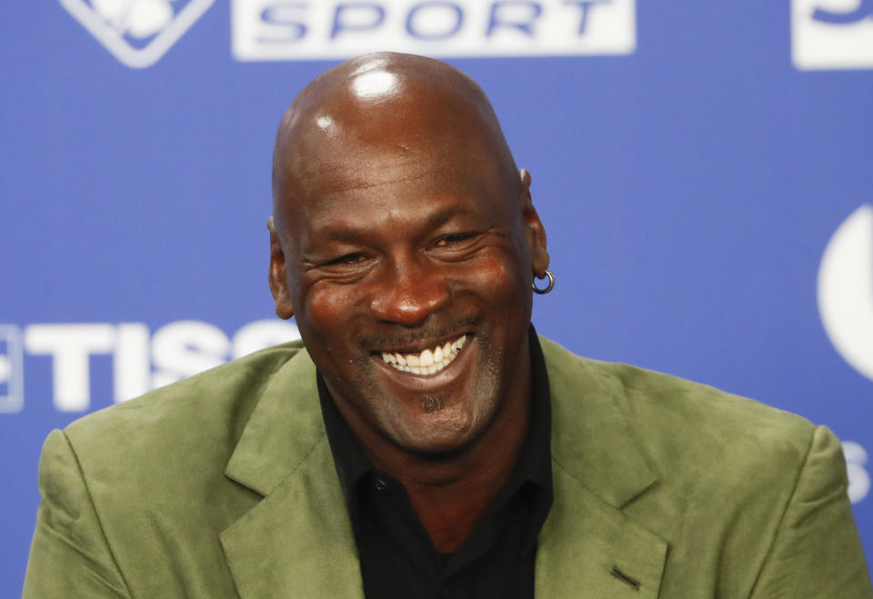 FILE - In this Jan. 24, 2020, file photo, former basketball superstar Michael Jordan speaks during a news conference ahead of an NBA basketball game between the Charlotte Hornets and the Milwaukee Bucks in Paris. The Associated Press asked eight of the greatest current and former champions, including Jordan, from seven different sports to find out what impressed them most about Tom Brady. (AP Photo/Thibault Camus, File)