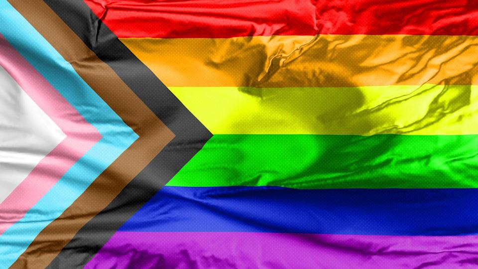 """<p>In recent years, the updated pride flag, which includes both black and brown stripes to acknowledge queer people of color, as well as pink, white, and blue (the colors of the transgender pride flag), has become more popular. </p><p>""""This flag recognizes intersections within the LGBTQ+ community honoring LGBTQ+ people of color—whose activism inspired the very first Pride—as well as different gender identities,"""" London mayor <a href=""""https://www.forbes.com/sites/jamiewareham/2020/07/12/why-lgbt-people-have-started-using-a-new-pride-flag-nhs-black-lives-matters/?sh=6b354a98125a"""" rel=""""nofollow noopener"""" target=""""_blank"""" data-ylk=""""slk:Sadiq Khan told Forbes"""" class=""""link rapid-noclick-resp"""">Sadiq Khan told <em>Forbes</em></a>.</p>"""