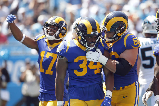 FILE - In this Sept. 8, 2019, file photo, Los Angeles Rams running back Malcolm Brown (34) is congratulated by center Austin Blythe (66) and wide receiver Robert Woods (17) following Brown's touchdown against the Carolina Panthers during the first half of an NFL football game in Charlotte, N.C. If teams are unable to hold offseason team workouts due to the coronavirus pandemic, Andrew Whitworth and Blythe believe continuity and experience will be valuable commodities in the NFL this fall. That's one area where the Rams' offensive line should be much stronger this season. (AP Photo/Brian Blanco, File)