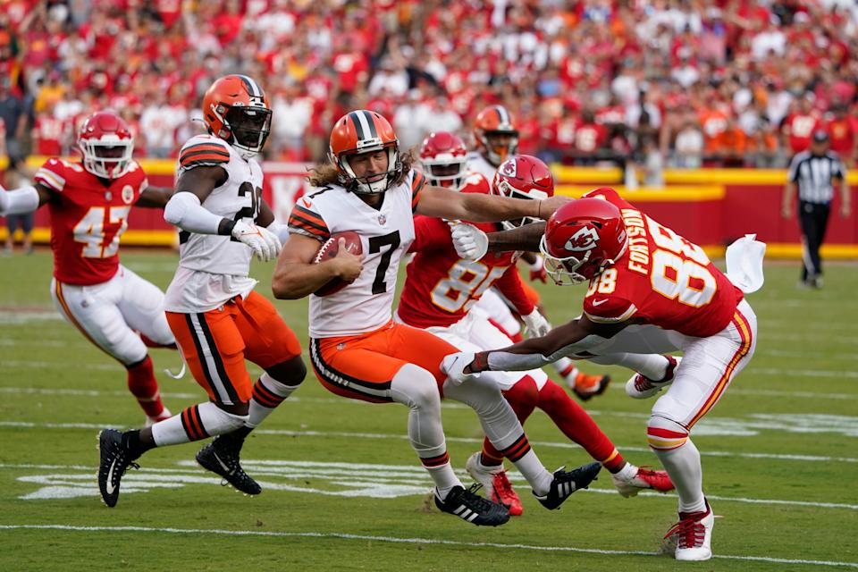 Cleveland Browns punter Jamie Gillan (7) runs with the ball after muffing a punt attempt during the second half of an NFL football game against the Kansas City Chiefs Sunday, Sept. 12, 2021, in Kansas City, Mo. (AP Photo/Ed Zurga)