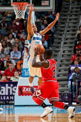 NEW ORLEANS, LA - FEBRUARY 19: Nate Robinson #2 of the Chicago Bulls fakes a shot attempt against Brian Roberts #22 of the New Orleans Hornets on February 19, 2013 at the New Orleans Arena in New Orleans, Louisiana. (Photo by Layne Murdoch/NBAE via Getty Images)