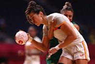 <p>Lara Gonzalez Ortega of Team Spain is challenged by Adriana Cardoso of Team Brazil during the Women's Preliminary Round Group B handball match between Spain and Brazil on day six of the Tokyo 2020 Olympic Games at Yoyogi National Stadium on July 29, 2021 in Tokyo, Japan. (Photo by Dean Mouhtaropoulos/Getty Images)</p>