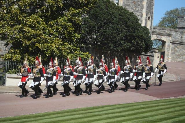 A dismounted detachment of The Life Guards and The Blues & Royals