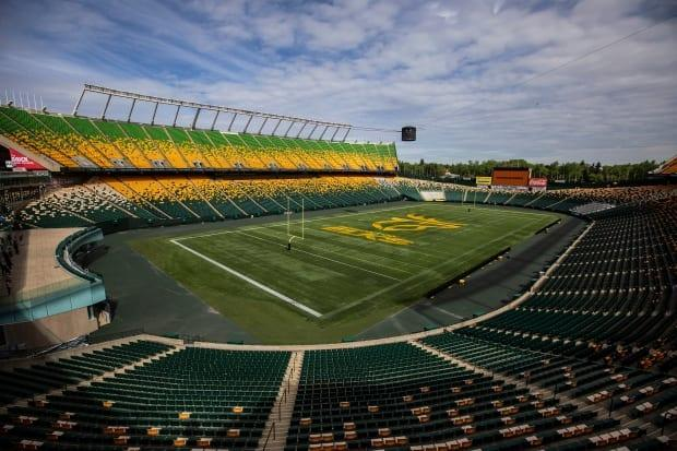 Football fans wanting to attend events at Commonwealth Stadium as of Oct. 15 will be required to present proof of being fully vaccinated or proof of a negative COVID-19 test. (Jason Franson/The Canadian Press - image credit)