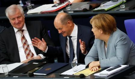 German Finance Minister Olaf Scholz reacts at the lower house of parliament (Bundestag) during a budget session in Berlin