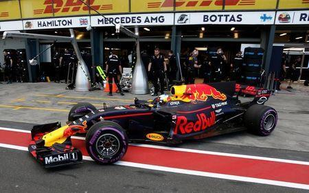 Formula One - F1 - Australian Grand Prix - Melbourne, Australia - 25/03/2017 Red Bull Racing driver Daniel Ricciardo of Australia pulls out of the team garage during the qualifying session. REUTERS/Brandon Malone -