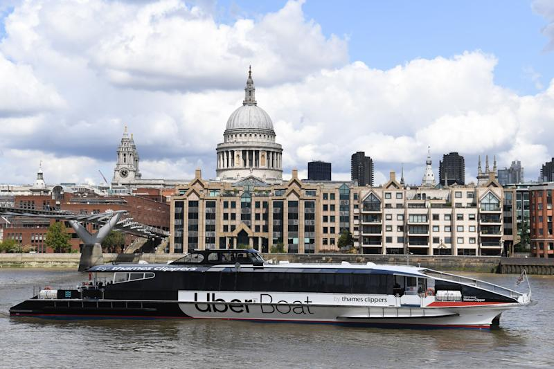 An Uber boat passes St Paul's cathedral in partnership with Thames clippers the boat tickets can be purchased via the ride hailing firm's app on August 3, 2020. (Photo by DANIEL LEAL-OLIVAS / AFP) (Photo by DANIEL LEAL-OLIVAS/AFP via Getty Images)