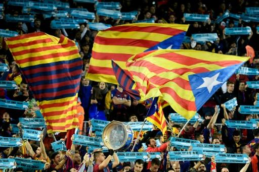 "Barcelona supporters wave Catalan pro-independence ""Estelada"" flags before the Clasico"