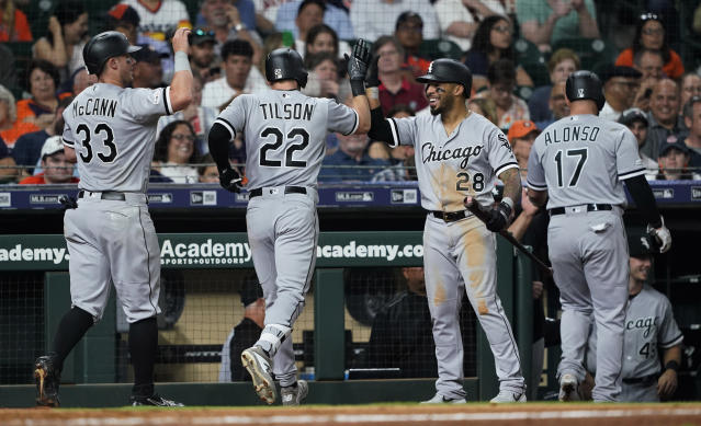 Chicago White Sox's Charlie Tilson (22) celebrates with Leury Garcia (28) and James McCann (33) after hitting a grand slam against the Houston Astros during the sixth inning of a baseball game Wednesday, May 22, 2019, in Houston. (AP Photo/David J. Phillip)