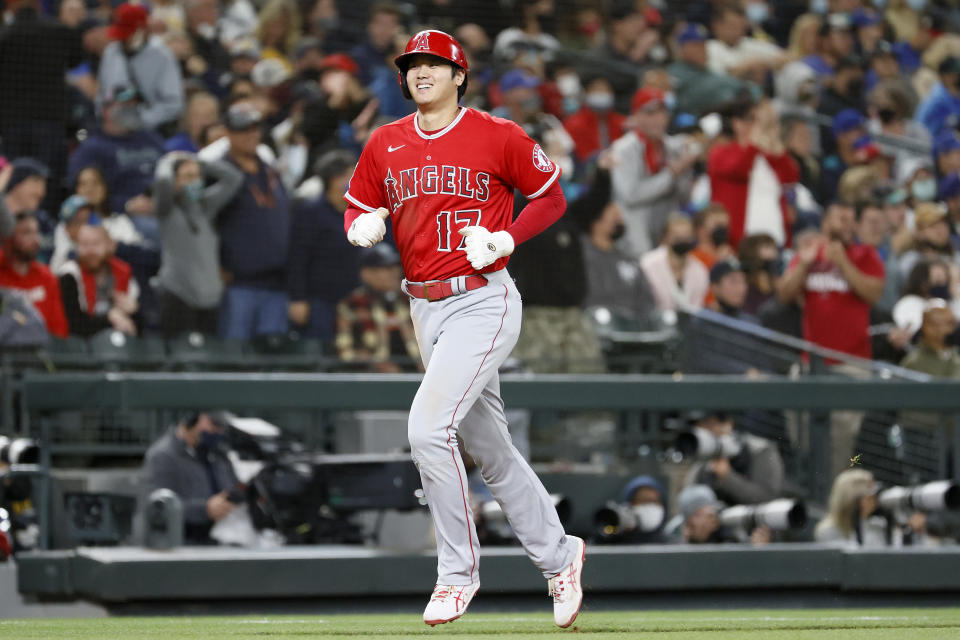 SEATTLE, WASHINGTON - OCTOBER 02: Shohei Ohtani #17 of the Los Angeles Angels scores on a three-run home run by Jared Walsh #20 during the eighth inning against the Seattle Mariners at T-Mobile Park on October 02, 2021 in Seattle, Washington. (Photo by Steph Chambers/Getty Images)