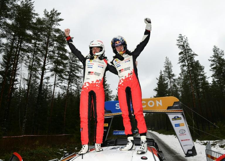 Elfyn Evans and co-driver Scott Martin after guiding their Toyota to victory at Rally Sweden