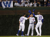 Chicago Cubs' Kyle Schwarber, left, Albert Almora Jr., center, and Jason Heyward celebrate the team's 7-4 win against the New York Mets in a baseball game Thursday, June 20, 2019, in Chicago. (AP Photo/Jim Young)