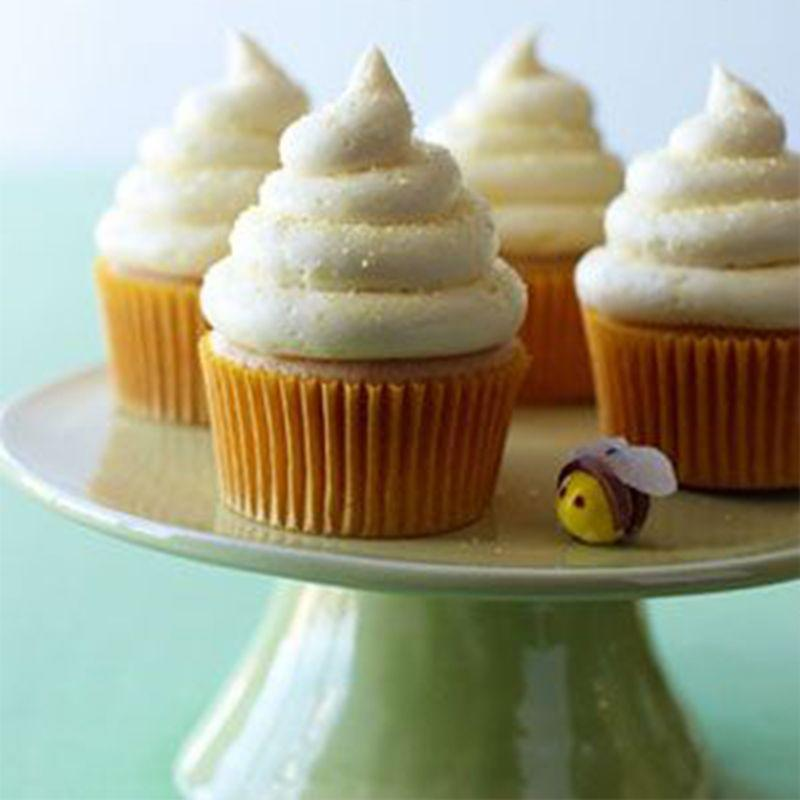 """<p>Not only is there honey in the batter, but there's also honey in the icing to create a strong flavor Dad will love.</p><p><a href=""""https://www.womansday.com/food-recipes/food-drinks/recipes/a11157/lemon-honey-cupcakes-recipe-122603/"""" rel=""""nofollow noopener"""" target=""""_blank"""" data-ylk=""""slk:Get the Lemon-Honey Cupcakes recipe."""" class=""""link rapid-noclick-resp""""><em><strong>Get the Lemon-Honey Cupcakes recipe.</strong></em></a></p>"""