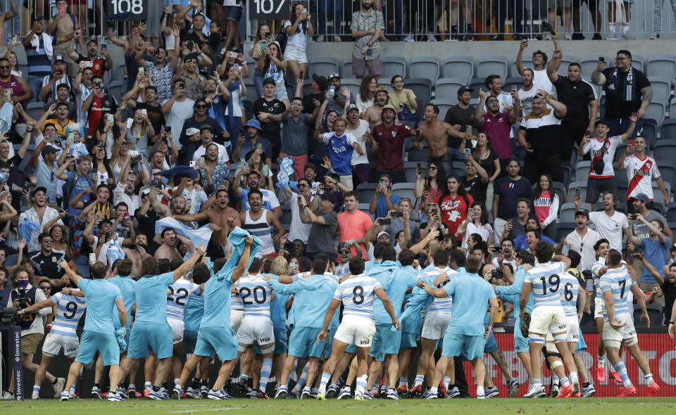 Argentina players wave to their supporters as they celebrate after the Tri-Nations rugby test between Argentina and New Zealand at Bankwest Stadium, Sydney, Australia, Saturday, Nov.14, 2020. Argentina defeated the All Blacks 25-15. (AP Photo/Rick Rycroft)