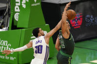 Sacramento Kings guard Justin James (10) blocks a shot-attempt by Boston Celtics forward Grant Williams (12) in the first half of an NBA basketball game, Friday, March 19, 2021, in Boston. (AP Photo/Elise Amendola)