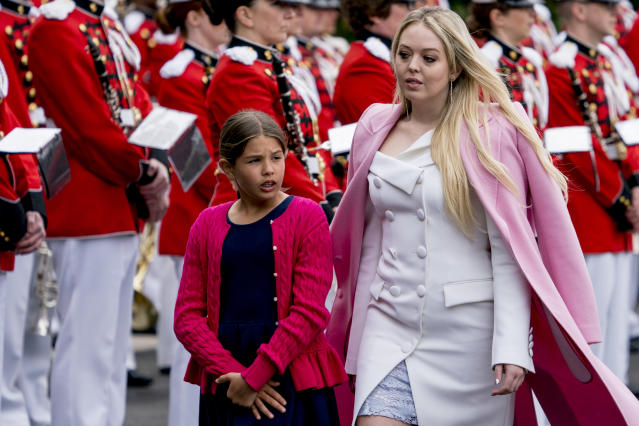 Tiffany Trump later wore a pink coat over the dress. (Photo: AP Photo/Andrew Harnik)