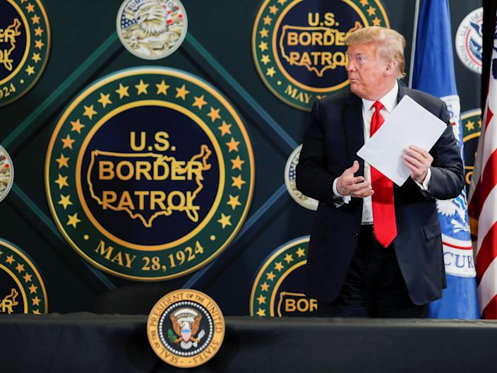 Donald Trump stands up to leave after participating in a roundtable briefing on border security at the Border Patrol Yuma Station in Arizona, June 23, 2020. (REUTERS)