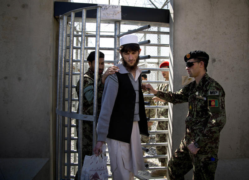 An Afghan prisoner leaves with his belongings from the Parwan Detention Facility after the U.S. military gave control of its last detention facility to Afghan authorities in Bagram, outside Kabul, Afghanistan, Monday, March 25, 2013. The handover of Parwan Detention Facility ends a bitter chapter in American relations with Afghanistan's mercurial president, Hamid Karzai, who demanded control of the prison as a matter of national sovereignty. (AP Photo/Anja Niedringhaus)