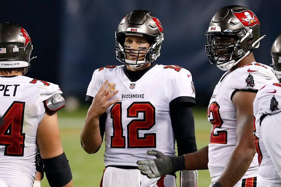 Tampa Bay Buccaneers quarterback Tom Brady (12) holds up four fingers thinking it was only fourth down after his team's final play of the game against the Chicago Bears.
