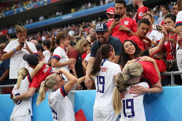 Players of the USA celebrate victory with family and friends in the crowd after the 2019 FIFA Women's World Cup France Final match between The United States of America and The Netherlands at Stade de Lyon on July 07, 2019 in Lyon, France. (Photo by Elsa/Getty Images)