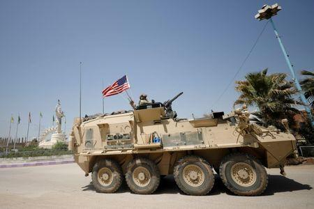 A U.S military vehicle travels in the town of Amuda, northern Syria April 29, 2017. REUTERS/Rodi Said/Files