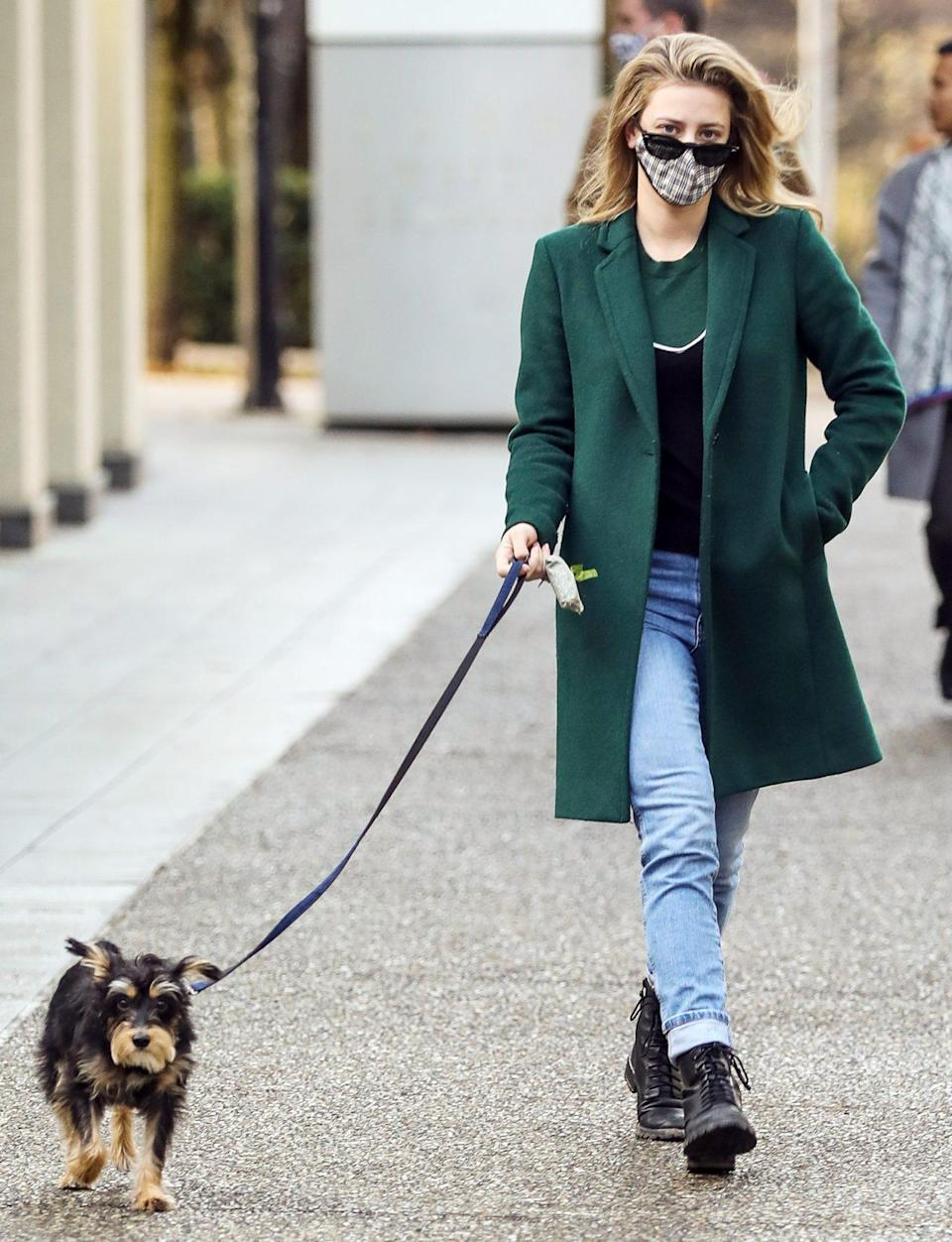 <p>Lili Reinhart makes her dog walk the catwalk on Saturday while taking her pup for a stroll in Vancouver, Canada.</p>