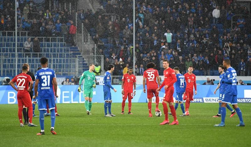Bayern Munich and Hoffenheim players kick the ball around aimlessly to protest vulgar fan signs at the end of their Bundesliga match on Saturday. (Photo by Matthias Hangst/Bongarts/Getty Images)