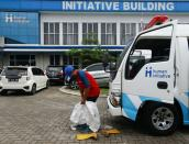 Volunteer ambulance drivers work around the clock to transport COVID-19 patients in Depok