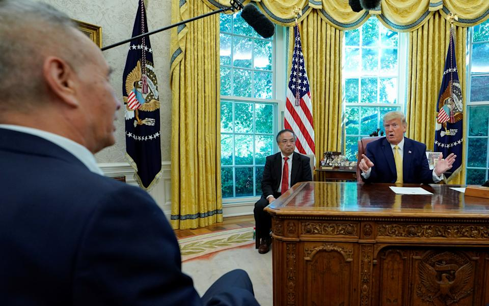 U.S. President Donald Trump talks during a meeting with China's Vice Premier Liu He in the Oval Office at the White House after two days of trade negotiations in Washington, U.S., October 11, 2019. REUTERS/Yuri Gripas