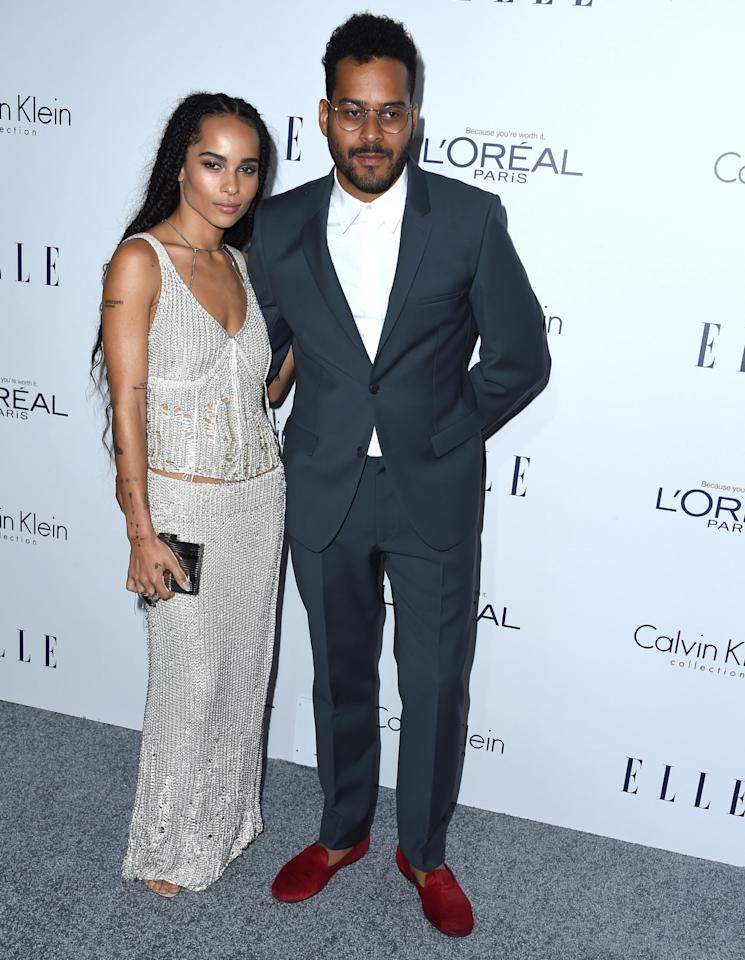 <p>On the heels of a <i>New York Times</i> profile, Twin Shadow walked the red carpet with his girlfriend, Zoe Kravitz, in a trim blue suit and velvet red slippers. She made a statement in a sparkly Calvin Klein gown (maybe a tank top and maxi skirt?) that showed off a sliver of midriff. </p>