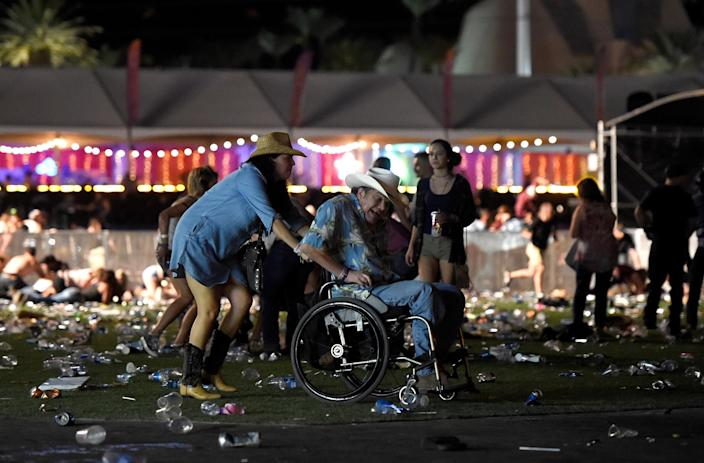 <p>A man in a wheelchair is taken away from the Route 91 Harvest country music festival after apparent gun fire was heard on Oct. 1, 2017 in Las Vegas. (Photo: David Becker/Getty Images) </p>