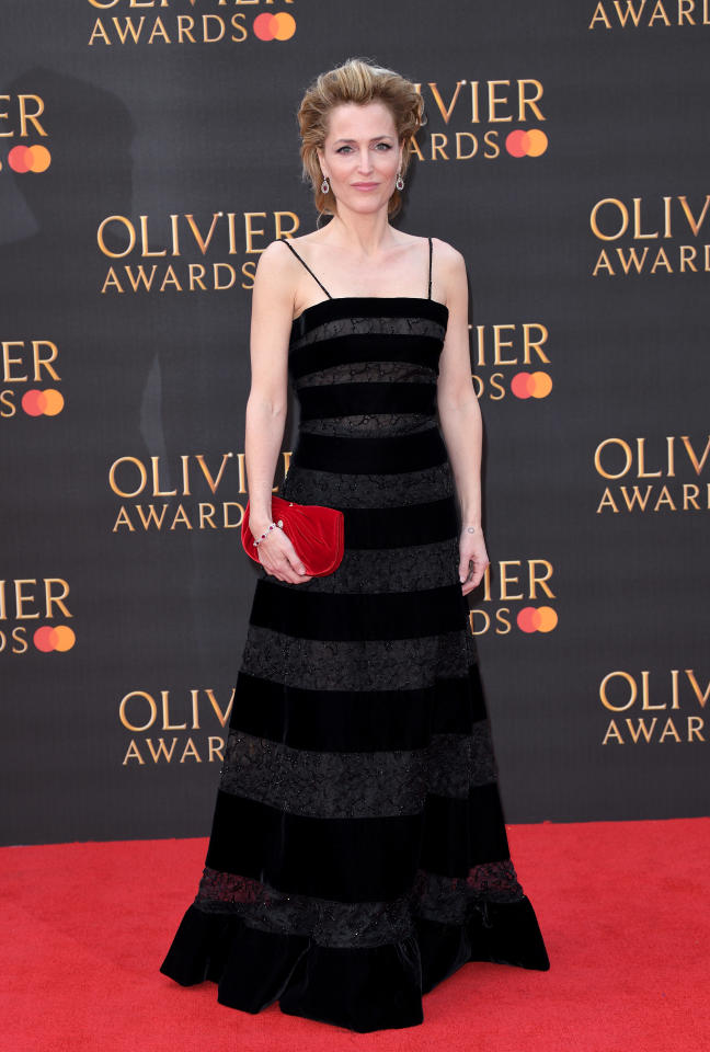 <p>The 50-year-old actress stole the spotlight in a slick black Armani gown with a punchy red clutch to finish. <em>[Photo: Getty]</em> </p>