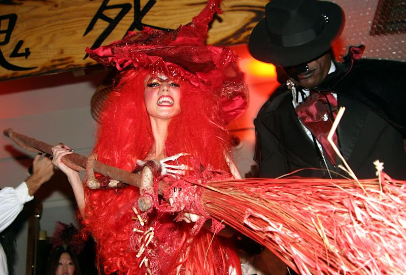 Heidi Klum, as a red haired vampire-witch hybrid, and Seal during Heidi Klum's Fifth Annual Halloween Party at Marquee Presented by World Selects Beer at Marquee in New York City, New York, United States on October 31st, 2004. Photo courtesy of Getty Images.