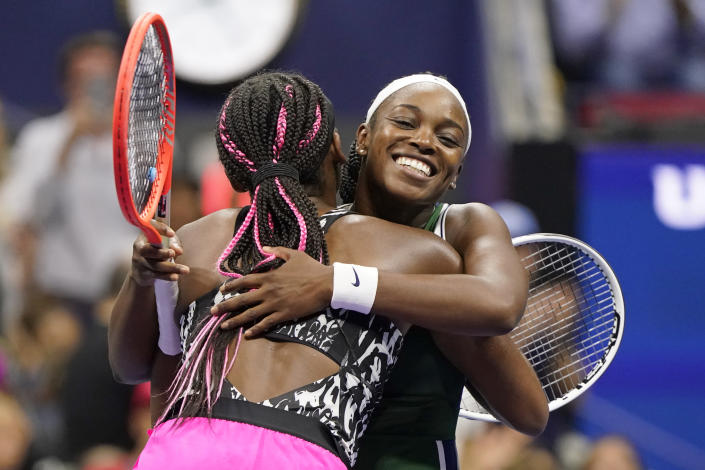 Sloane Stephens, of the United States, right, hugs Coco Gauff, of the United States, after Stephens won their match during the second round of the US Open tennis championships, Wednesday, Sept. 1, 2021, in New York. (AP Photo/John Minchillo)