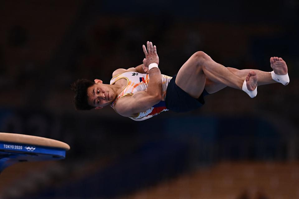 Philippines' Carlos Edriel Yulo competes in the vault event of the artistic gymnastics men's qualification during the Tokyo 2020 Olympic Games at the Ariake Gymnastics Centre in Tokyo on July 24, 2021. (Photo by Loic VENANCE / AFP) (Photo by LOIC VENANCE/AFP via Getty Images)