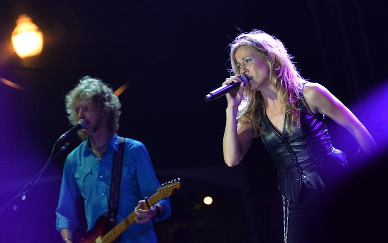 NASHVILLE, TN - MAY 20:  NASHVILLE, TN - MAY 20, 2013:  Singer/Songwriter Nashville Resident Sheryl Crow (right) with Guitarist Peter Stroud perform at The Music City Center Grand Opening Celebration on May 20, 2013 in Nashville, Tennessee.  (Photo by Rick Diamond/Getty Images)