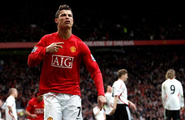 FILE PHOTO: Manchester United's Cristiano Ronaldo celebrates scoring his team's second goal in the 79th minute of their 3-0 victory over Liverpool in the Premier League.