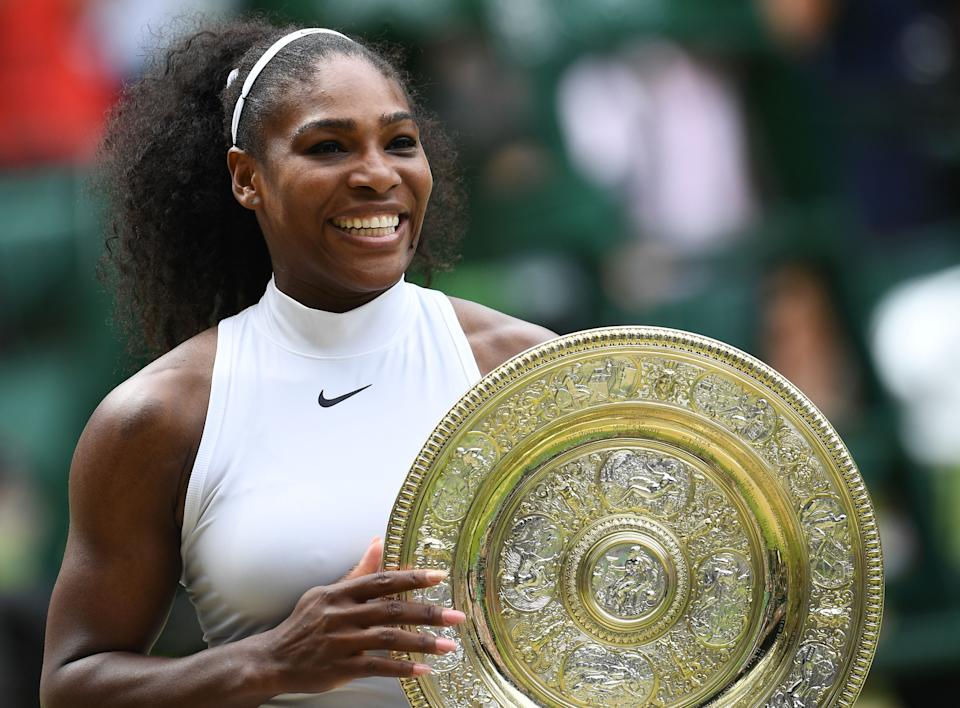 Serena Williams (pictured) poses with the winner's trophy at Wimbledon.