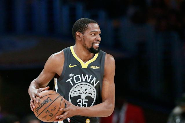"""<a class=""""link rapid-noclick-resp"""" href=""""/nba/players/4244/"""" data-ylk=""""slk:Kevin Durant"""">Kevin Durant</a> said he has sacrificed """"a lot of s---"""" to be with the <a class=""""link rapid-noclick-resp"""" href=""""/nba/teams/golden-state/"""" data-ylk=""""slk:Golden State Warriors"""">Golden State Warriors</a> these past three seasons — and it wasn't an easy decision for him to make. (Chris Elise/Getty Images)"""