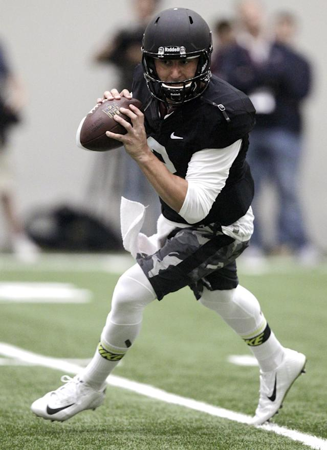 Texas A&M quarterback Johnny Manziel passes the ball during a drill at pro day for NFL football representatives in College Station, Texas, Thursday, March 27, 2014. (AP Photo/Patric Schneider)