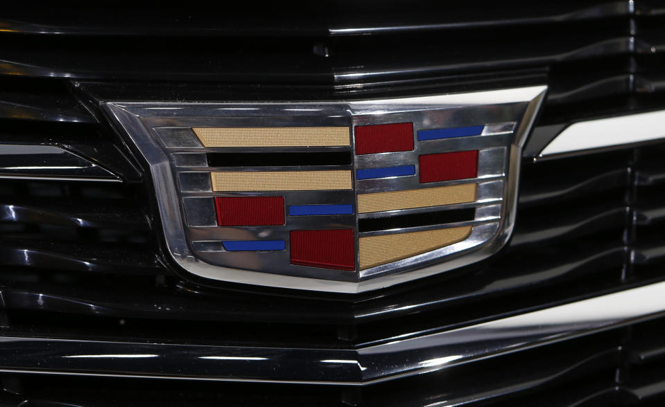 Detail view of the new Cadillac emblem on the ATS Coupe as it is unveiled during the press preview day of the North American International Auto Show in Detroit, Michigan January 14, 2014. REUTERS/Rebecca Cook (UNITED STATES - Tags: TRANSPORT BUSINESS)