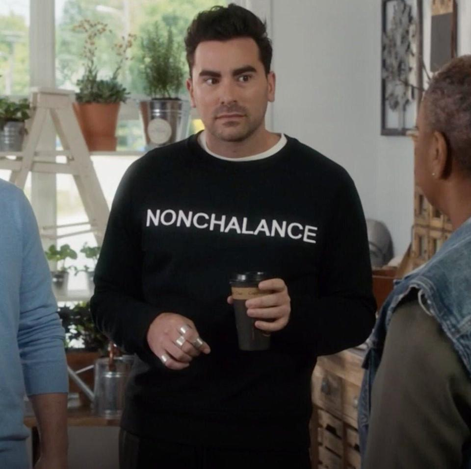 """Available in three colors in sizes S to 3X. <a href=""""https://fave.co/3qkAR4s"""" target=""""_blank"""" rel=""""noopener noreferrer"""">Get a replica of David's """"NONCHALANCE"""" sweatshirt for $20+ at Etsy</a>."""