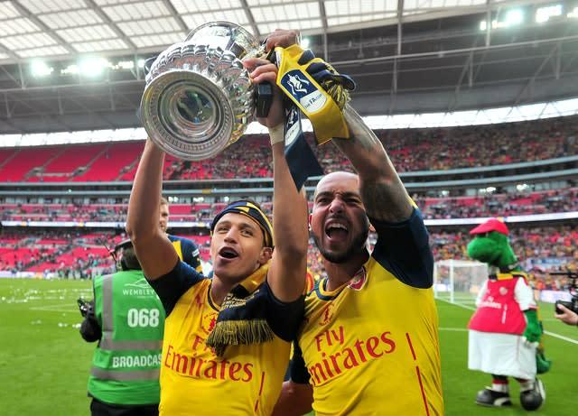 Sanchez (left) won the FA Cup twice with Arsenal (Anthony Devlin/PA)