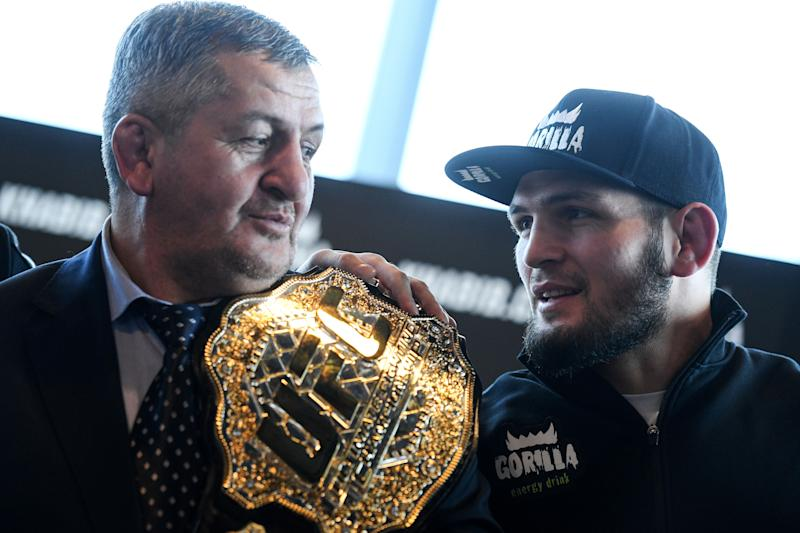Mixed martial arts (MMA) fighter Khabib Nurmagomedov and and his father Abdulmanap Nurmagomedov give a press conference in Moscow on November 26, 2018. (Photo by Kirill KUDRYAVTSEV / AFP) (Photo credit should read KIRILL KUDRYAVTSEV/AFP via Getty Images)
