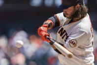 San Francisco Giants' Brandon Crawford connects for a single against the Texas Rangers during the sixth inning of a baseball game in San Francisco, Tuesday, May 11, 2021. (AP Photo/John Hefti)